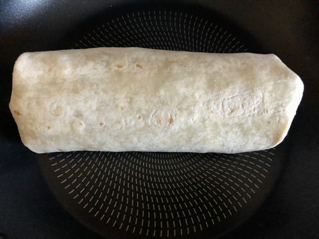 Southwest Chicken Sandwich Wrap seam side down in a hot skillet to brown the sides