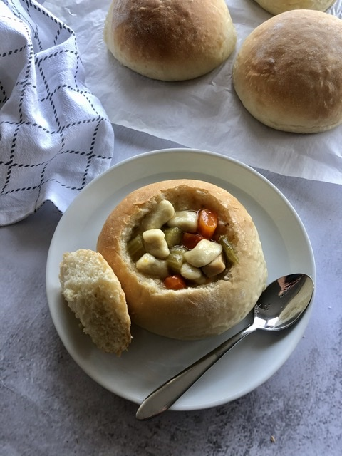 chicken dumpling soup in a bread bowl