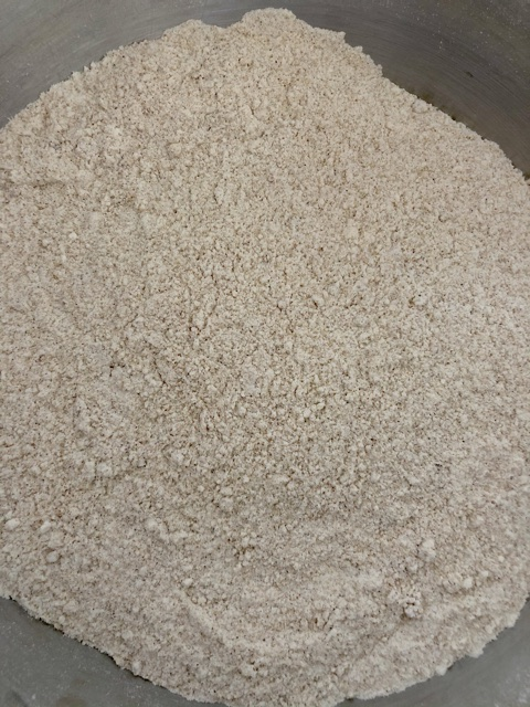 flour, sugar, brown sugar, baking soda, baking powder, cinnamon, ground ginger, nutmeg and salt mixed together for pumpkin chocolate chip cookies