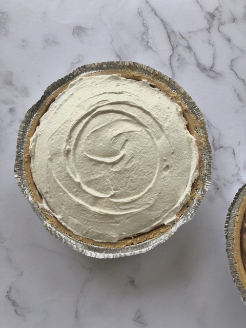 easy chocolate cream pie in graham cracker crust with whipped cream on top