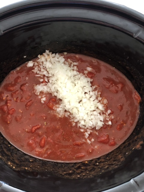 parmesan cheese added to the slow cooker spaghetti sauce