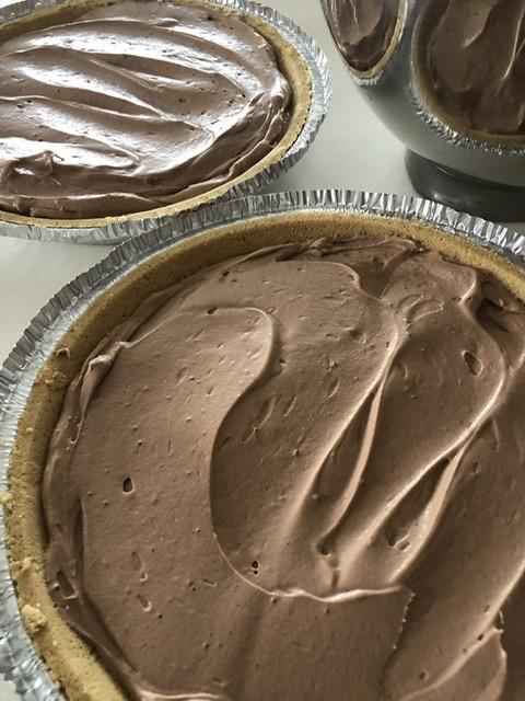2 chocolate cream pies in a graham cracker crust