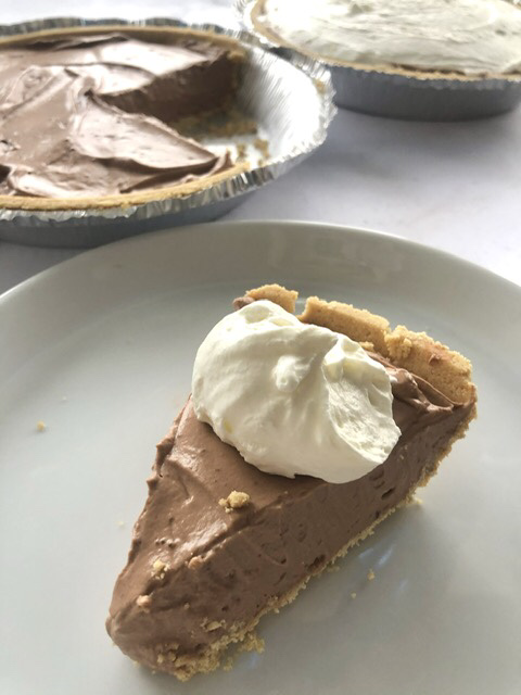 slice of easy chocolate cream pie with whipped cream on top