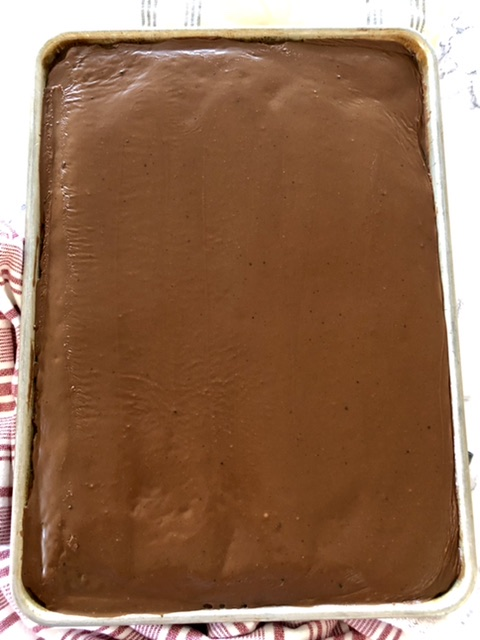Frosted Texas Sheet Cake in a half sheet pan