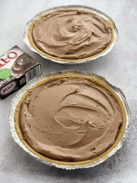 two easy chocolate cream pies with a box of instant chocolate pudding by them