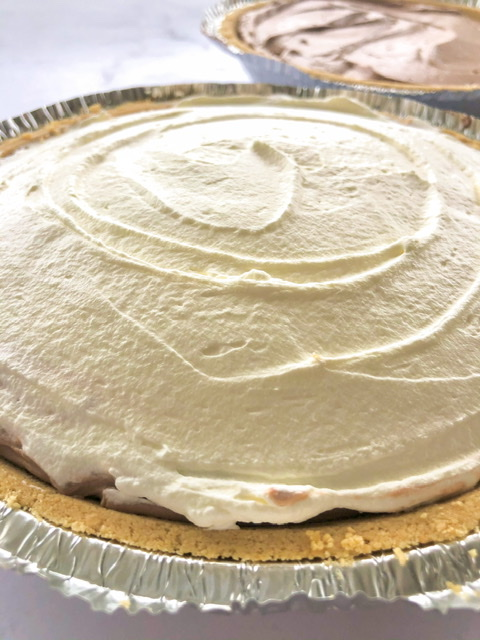 Easy chocolate cream pie with a graham cracker crust and whipped cream on top