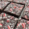 squares of chocolate fudge topped with crushed candy canes