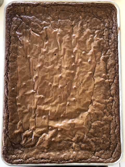 pan of fresh baked brownies in a half sheet pan