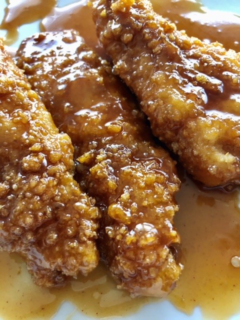 chicken fingers covered in sticky fingers sauce