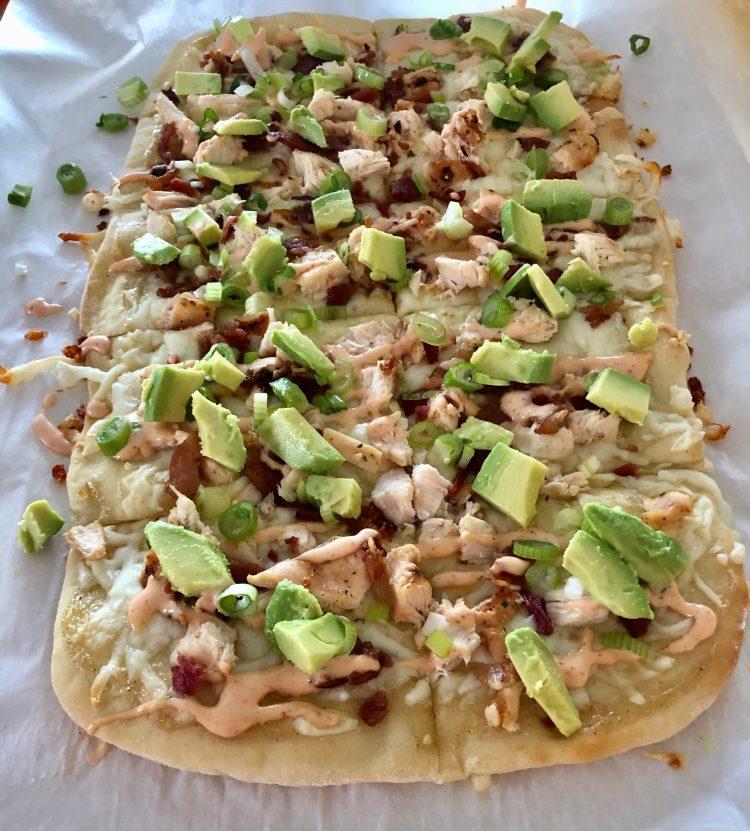 Chicken Bacon Avocado Flatbread cut into pieces for serving
