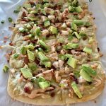 Chicken Bacon Avocado Flatbread cut into pieces for serving
