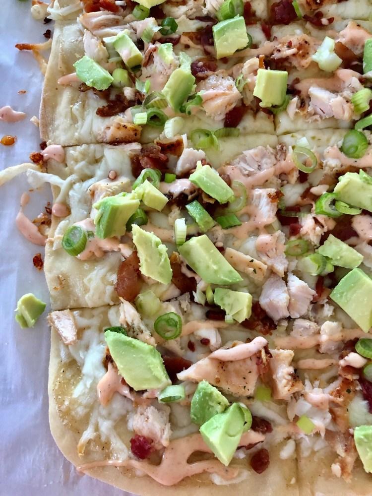 Chicken Bacon Avocado Flatbread with sriracha ranch drizzle