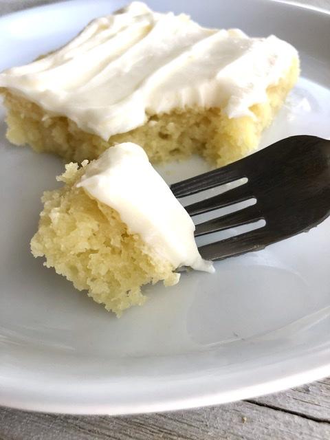 a fork taking a bite of the lemon sheet cake