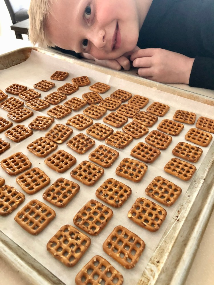 pretzels lined up on a baking sheet with parchment paper