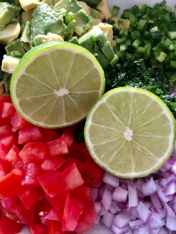 limes, tomatoes, onions, cilantro, avocado, jalapeno for avocado salsa