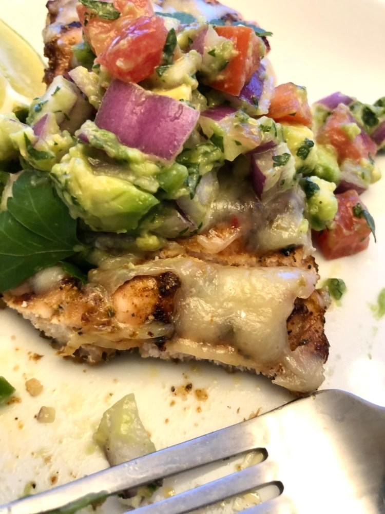 Grilled Chicken with Avocado Salsa being eaten