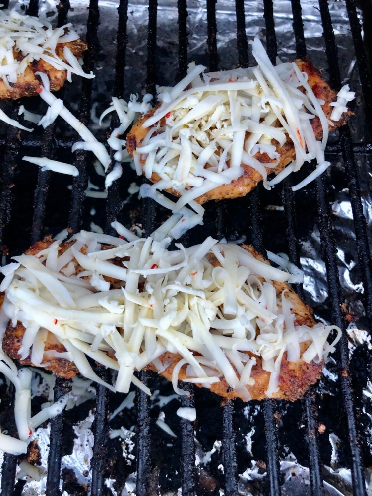 grated/shredded pepper jack cheese on top of the grilled chicken