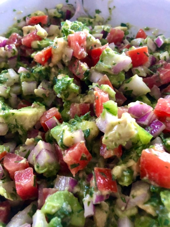 fresh avocado salsa mixed up and ready to put on the chicken