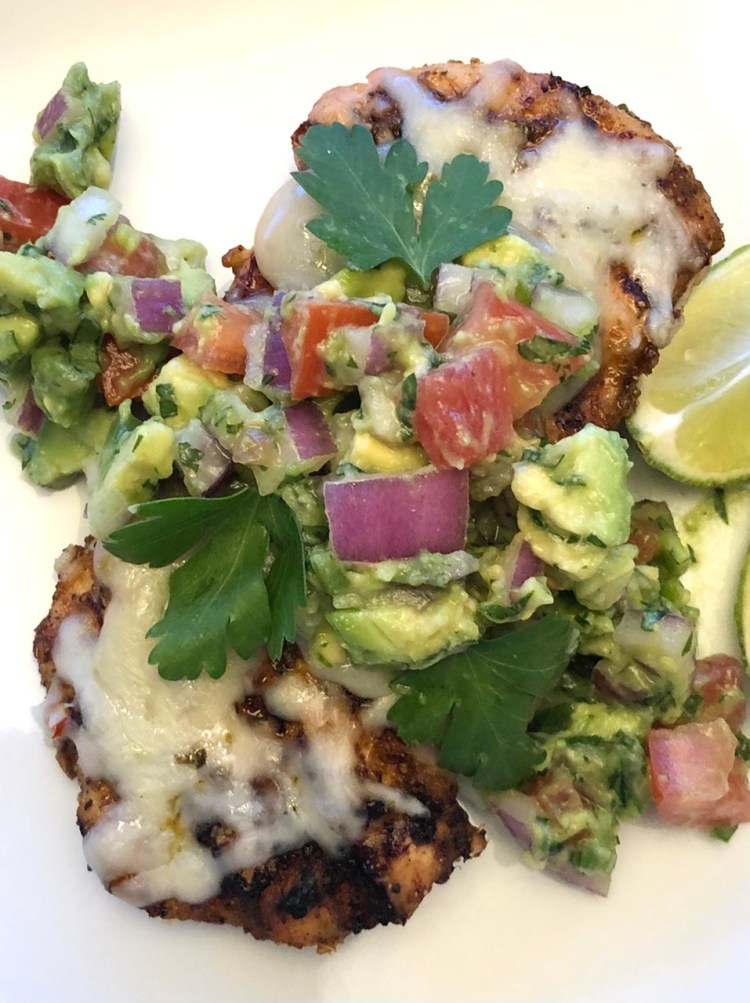 grilled chicken topped with melted cheese and avocado salsa