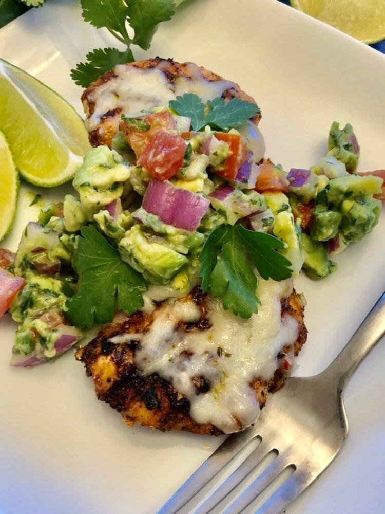 Grilled Chicken with Avocado Salsa on a plate with a fork
