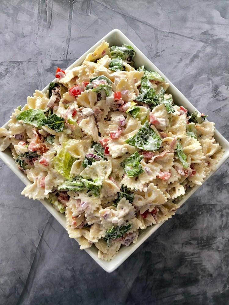 above shot of BLT pasta salad in a serving dish