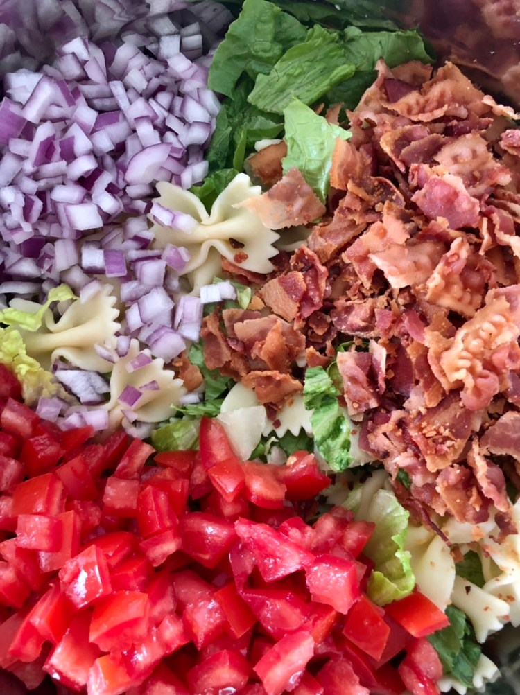 pasta, lettuce, tomatoes, onions, and bacon for BLT salad
