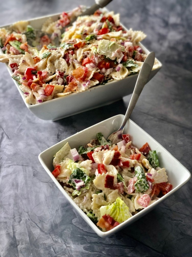 large serving bowl of blt pasta salad with a smaller bowl of blt pasta salad next to it