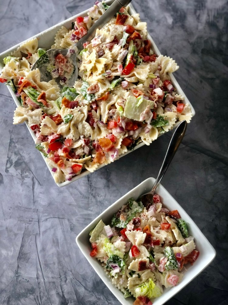 above shot of BLT pasta salad in a large bowl with a smaller dish of the blt salad next to it