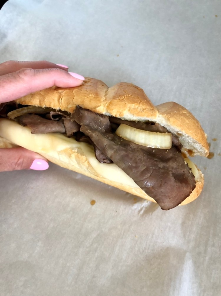 French Dip sandwich being held together