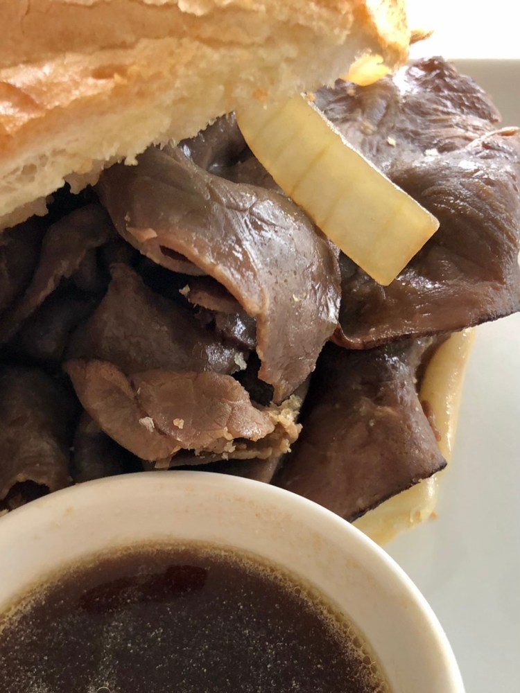 up close shot of the roast beef French Dip sandwich