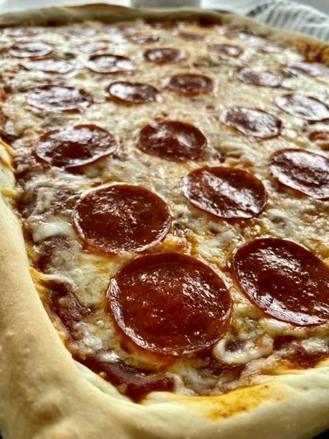 up close shot of sheet pan pizza