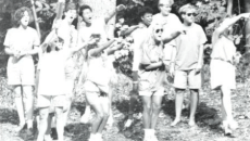 Students cheering at a Homecoming event. Photo from 1990 edition of The Drift