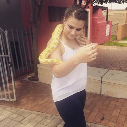 A woman in Soweto had various exotic animals and let Rapisarda hold a snake. Photo courtesy of Maria Rapisard.