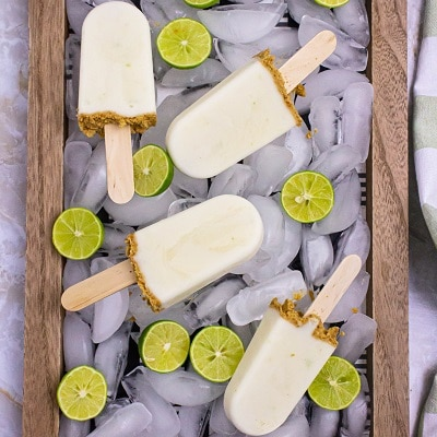 popsicles on a tray with ice and key limes
