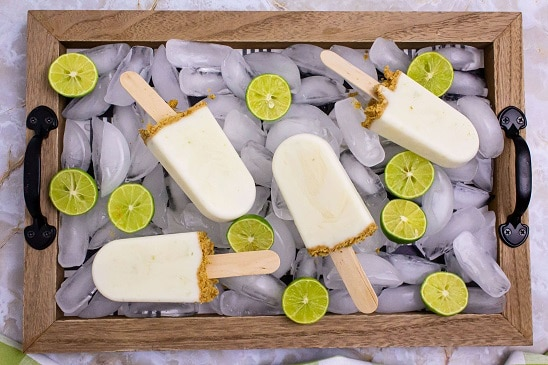tray of ice with key limes and popsicles on it
