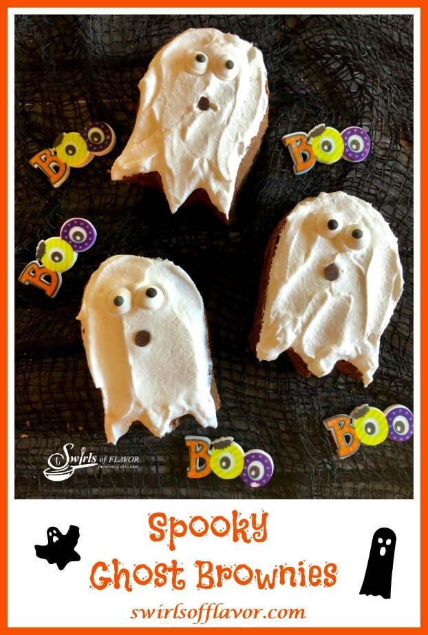 3 Brownies in the shape of ghosts with white icing and edible eye balls