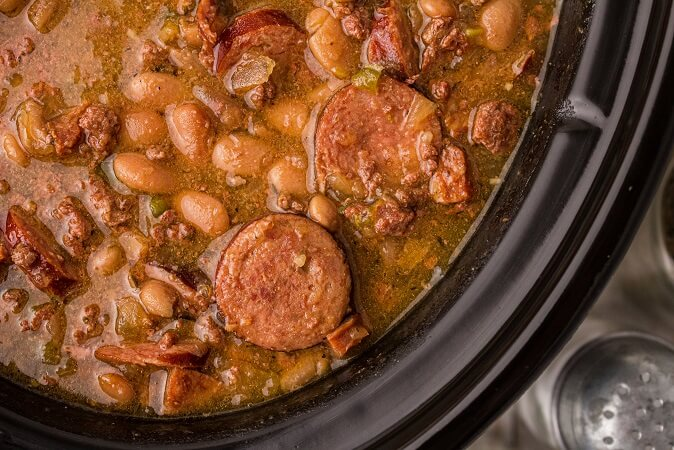 close up of pinto beans and sausage in a crock pot