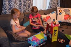 Ava and Abby opening presents at the end of the day.