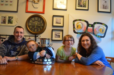 The Cain family with Aiden's consolation trophy.
