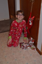 Abby in front of her stocking