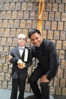 Aiden with the priest after the ceremony.
