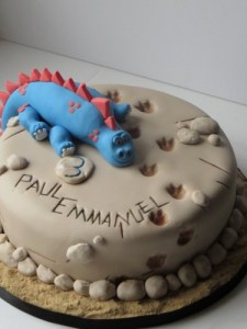 Dinosaur footprints birthday cake