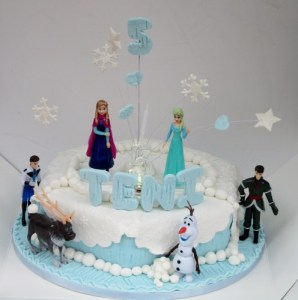 Disneys Frozen Fifth Birthday Cake with Keepsake toppers and snowflake spray