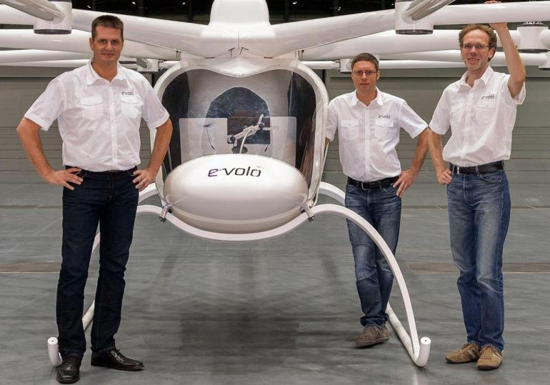 Some of the company design staff pose with the Evolo after its first flight.  Image Source: company website