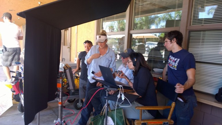 Director Daniel Kaufman and team reviewing video clips.