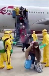 Passengers sprayed with hoses on runway after flying from hot zone