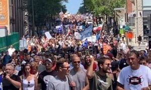 Thousands gather in Quebec to push back against mandatory mask mandate