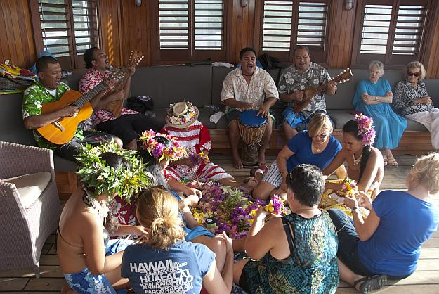 Polynesian musicians and artists share their talents with Wind Spirit guests while under sail