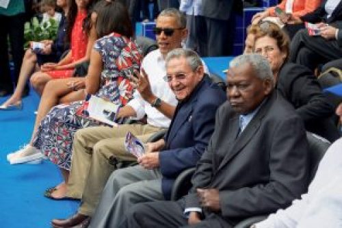 President Obama With Cuban President Castro at Estadio Latinoamericano in Havana, Cuba U.S. President Barack Obama sits with Cuban President Raul Castro at the Estadio Latinoamericano in Havana, Cuba, as he members of a U.S. delegation including U.S. Secretary of State John Kerry attend an exhibition game on March 22, 2016, between the Cuban National Baseball Team and the Tampa Bay Rays. [State Department photo/ Public Domain]