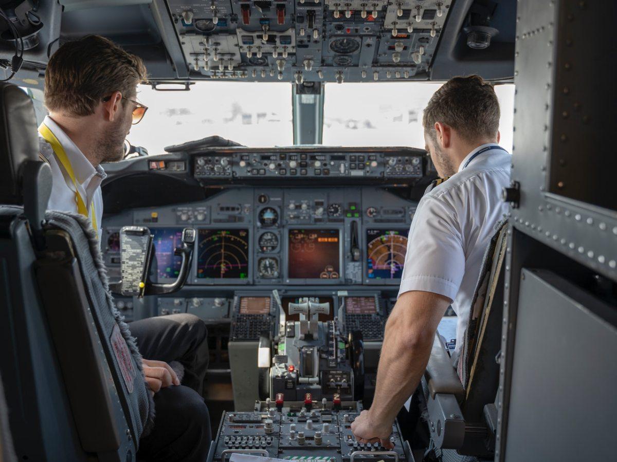 two-pilots-sitting-inside-plane
